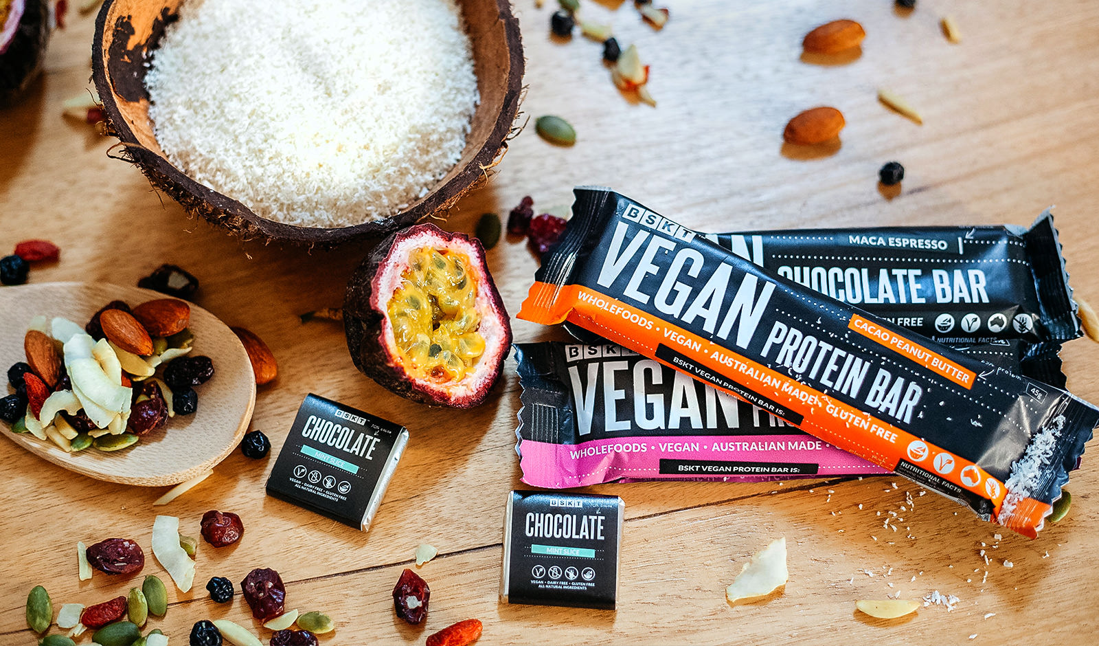 An image of protein bars, passionfruit and coconut