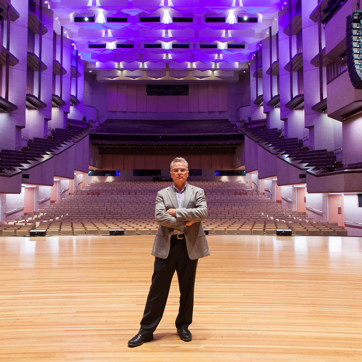Man standing in auditorium
