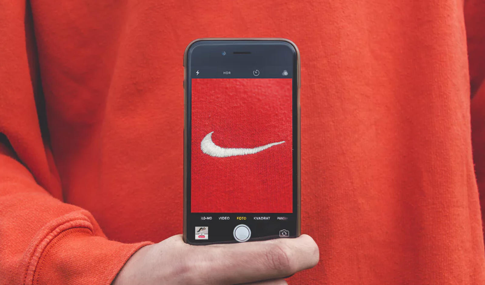 a mobile phone with the nike symbol on the screen