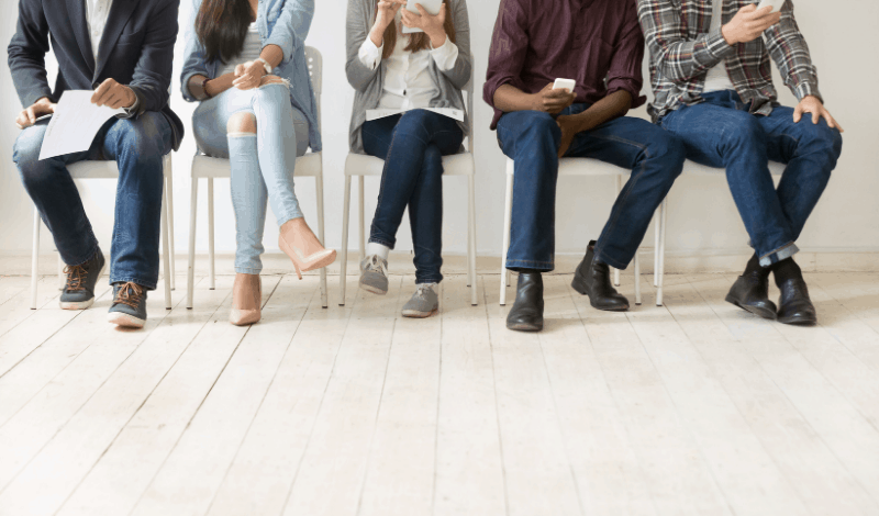 How to do customer research like a pro. Below the neck image of five people sitting in a focus group.